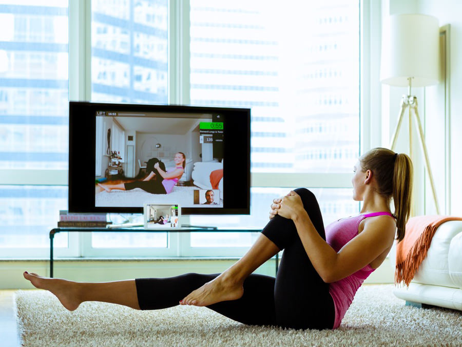Housewife doing online fitness training
