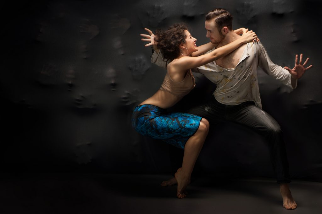 Young couple dancing contemporary. Photo in studio